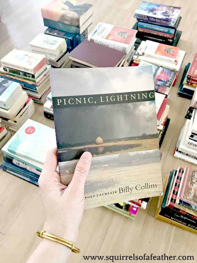 Holding a book to see if it sparks joy KonMari-style