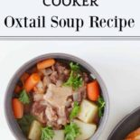 Oxtail soup in a bowl next to bread