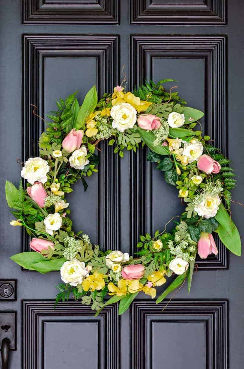 Beautiful spring wreath with pink and yellow flowers