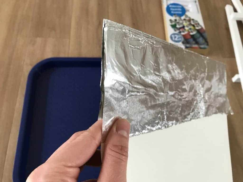 Folding the foil to cover the paper