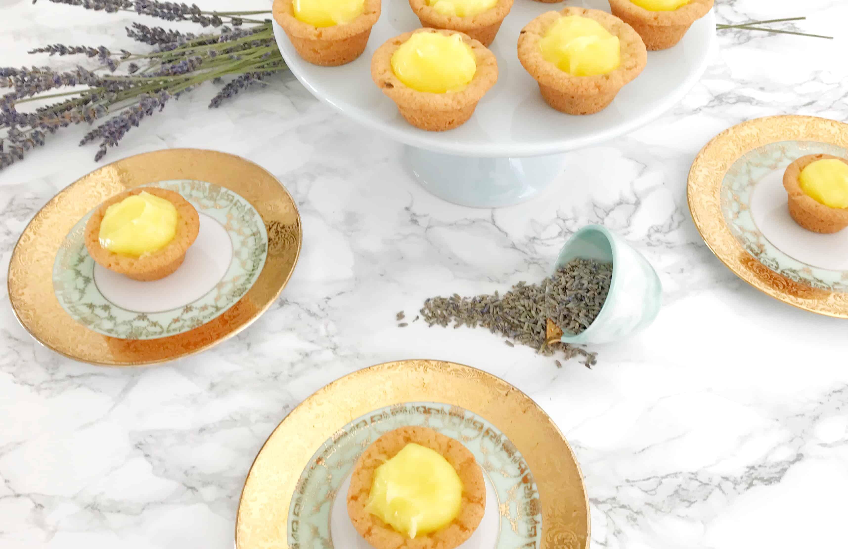 miniature lavender and lemon tarts on plates