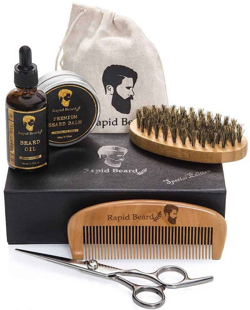 A beard grooming kit with brush and comb