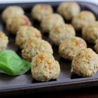 Kid friendly meatballs on a cookie sheet