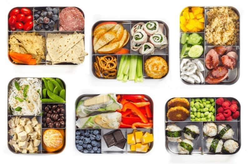 Healthy lunch boxes on a white background