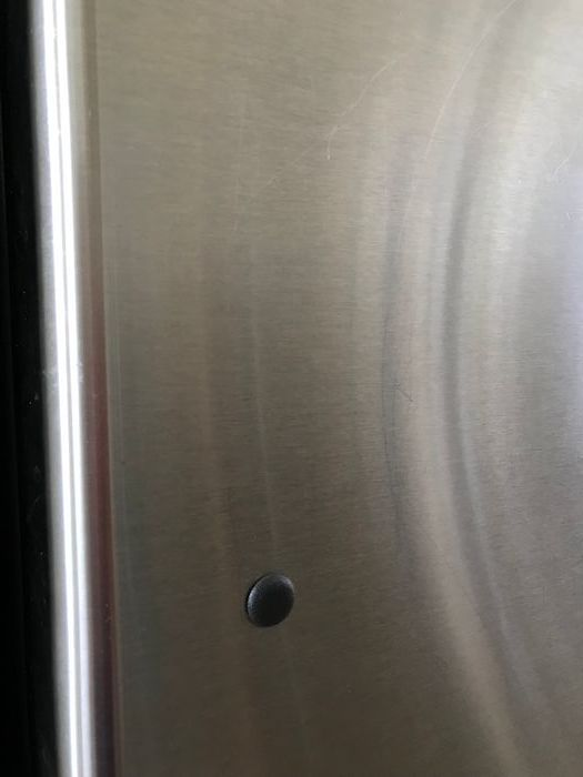 Picture of stainless steel grain on fridge