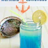 But mermaid lemonade on a table next to a shell