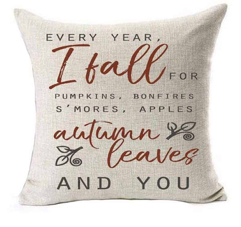 A pillow with text about loving fall