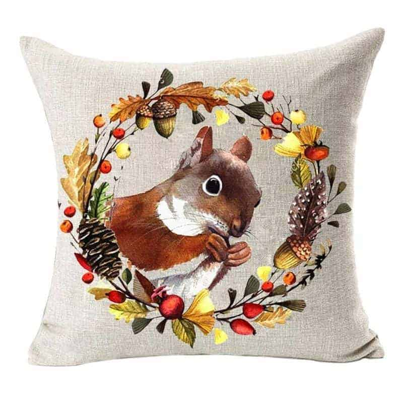 Squirrel pillow with a flower wreath