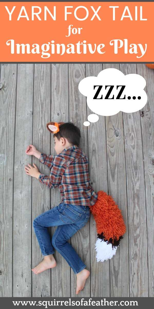 A boy wearing a fox tail costume