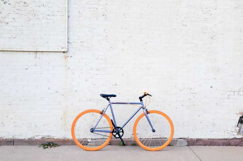 A colorful bicycle against a white wall