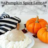 A pumpkin spice latte on a table