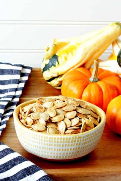 A plate full of pumpkin seeds and gourds