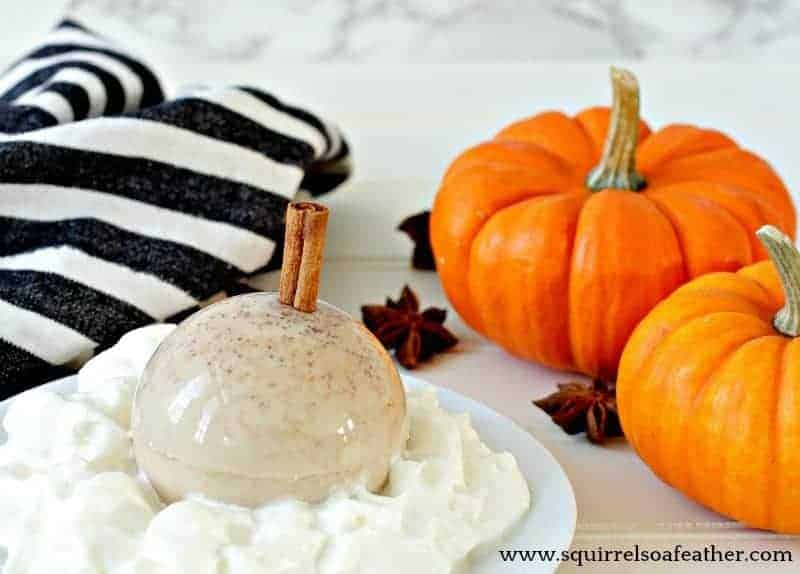 A pumpkin spice latte dessert with pumpkins