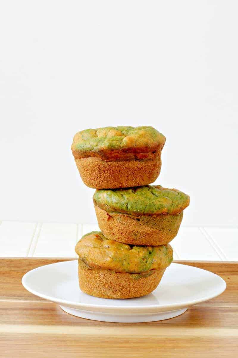Three butternut squash muffins piled on a plate