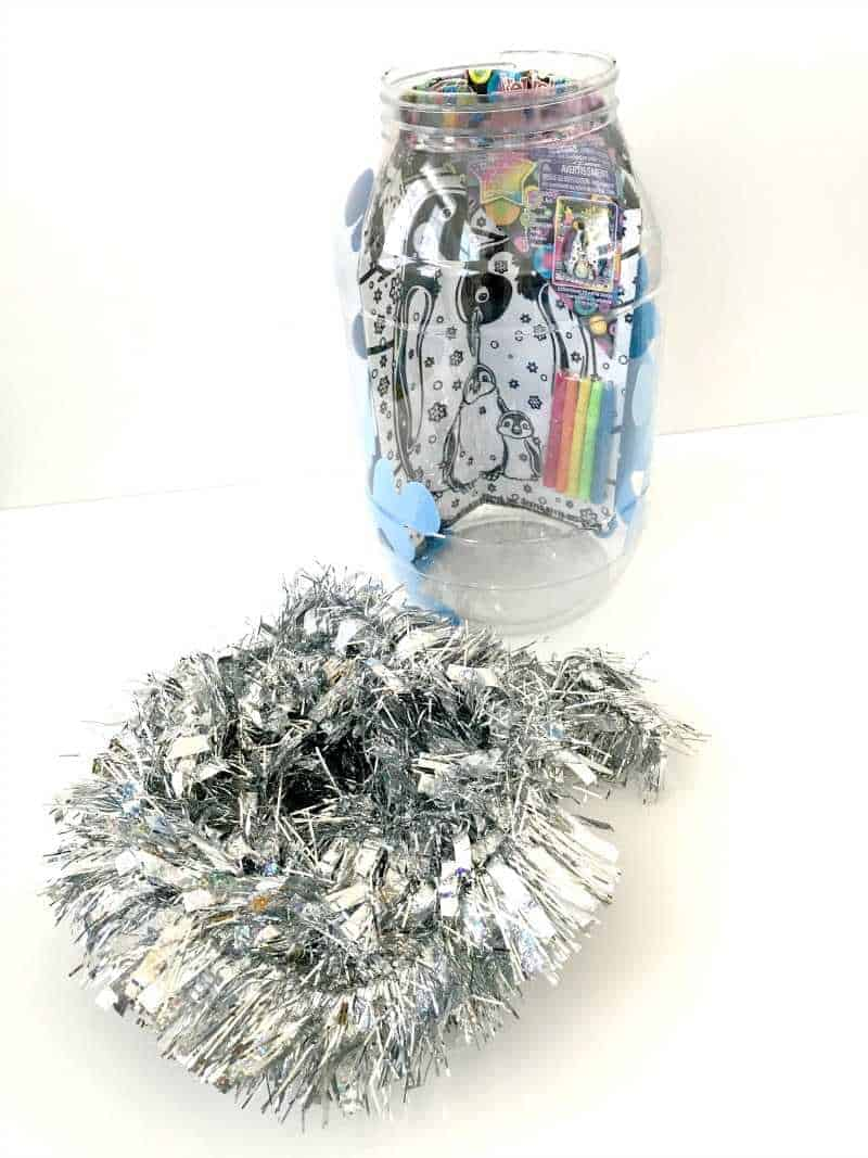 Filling container with tinsel