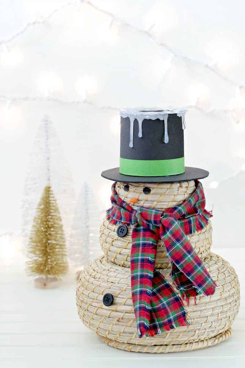 A cute snowman craft with hat and scarf