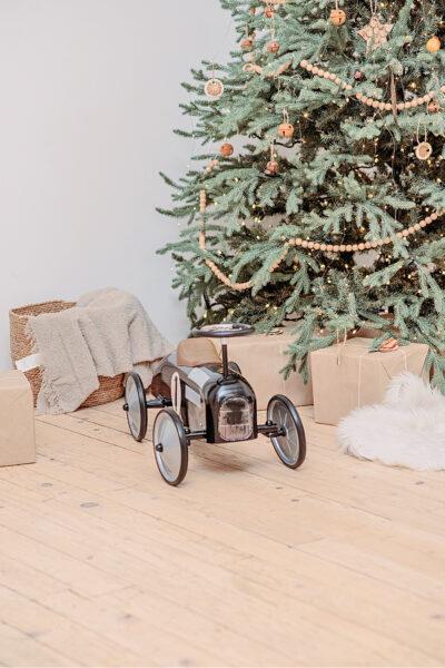 A cute christmas on a budget gift under a minimalist Christmas tree