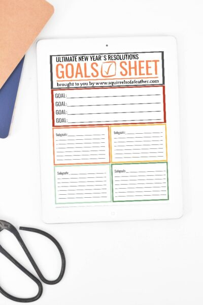 A free New Year's resolutions printable on a table by scissors