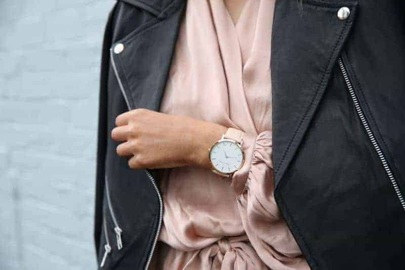 A woman in pick wearing a watch