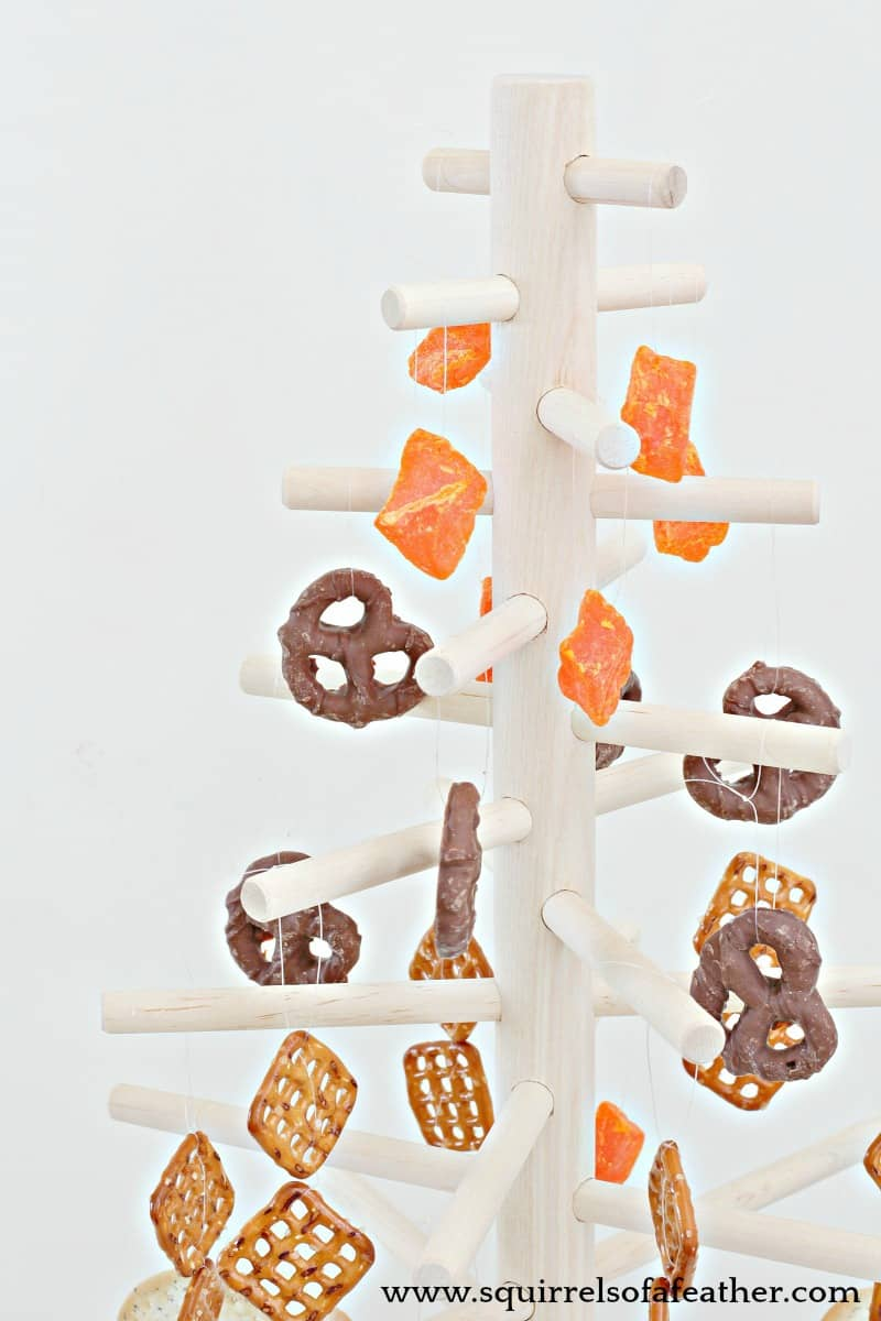 Close up of wooden dowel Christmas tree edible decor.
