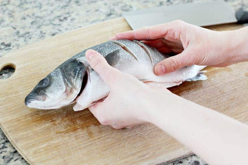 Cutting a Chinese fish for Chinese New Year