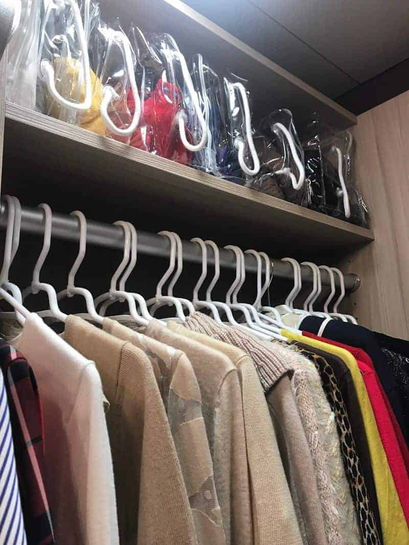 Using uniform hangers to organize closet