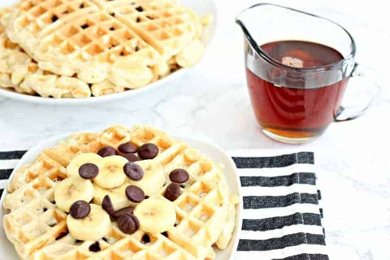 A table with chocolate chips waffles and syrup