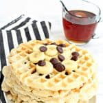 Chocolate chip waffles topped with chocolate chips and bananas