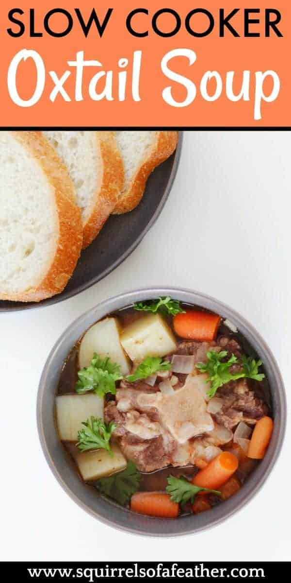 Slow cooker oxtail soup in a bowl next to bread