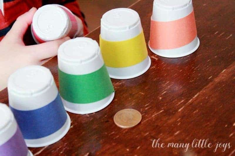 A colorful St. Patrick's Day activity with cups and gold coin