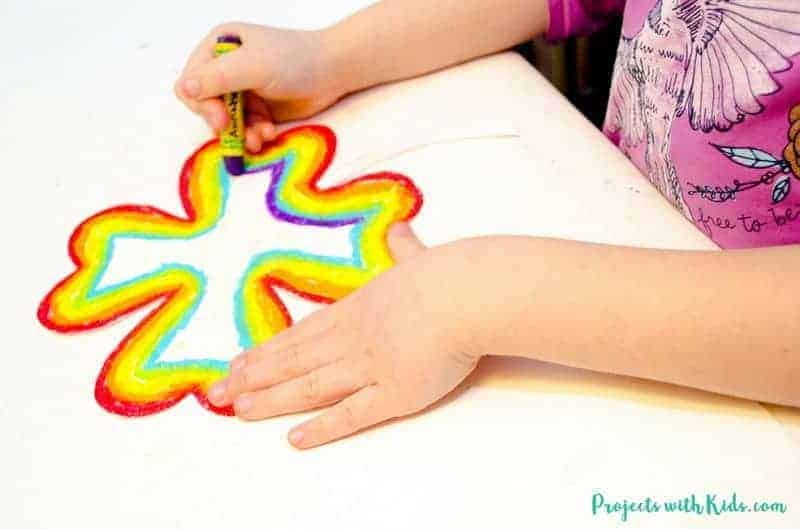 A child drawing a shamrock
