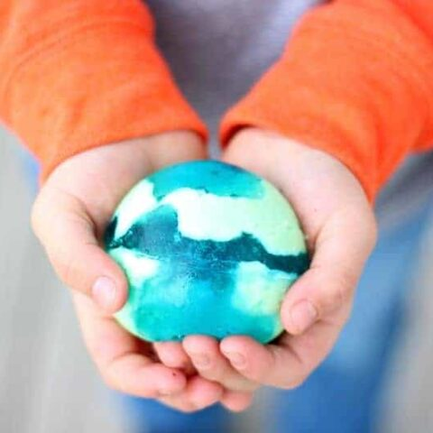 Boy holding blue and green jello ball