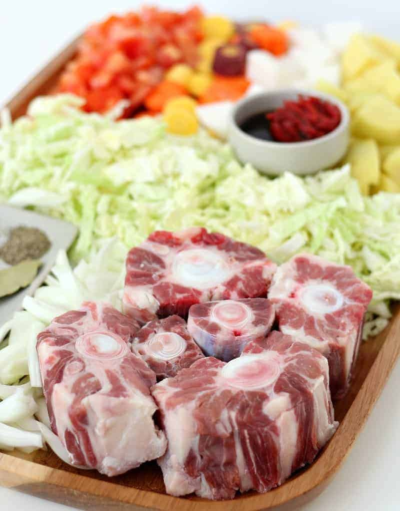 Fresh oxtail and vegetables on a tray