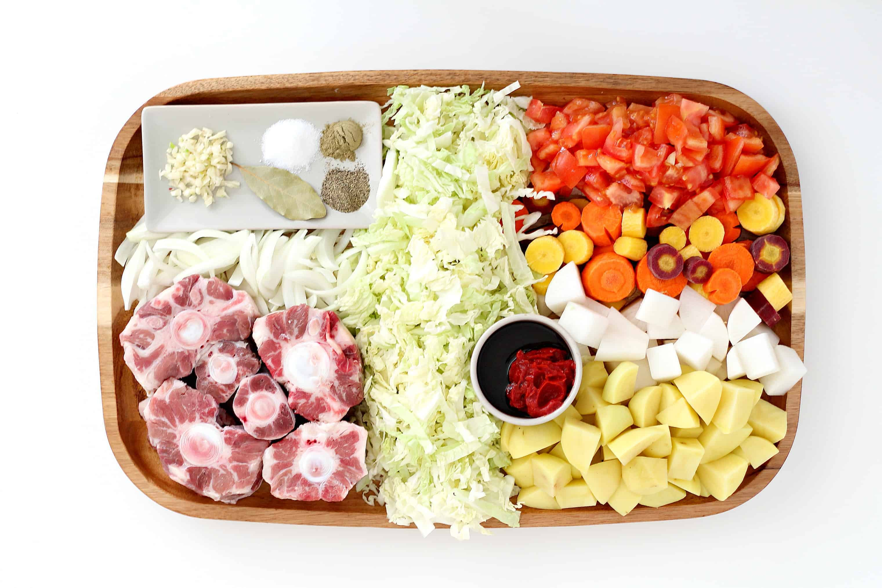 Flat lay of oxtail soup ingredients