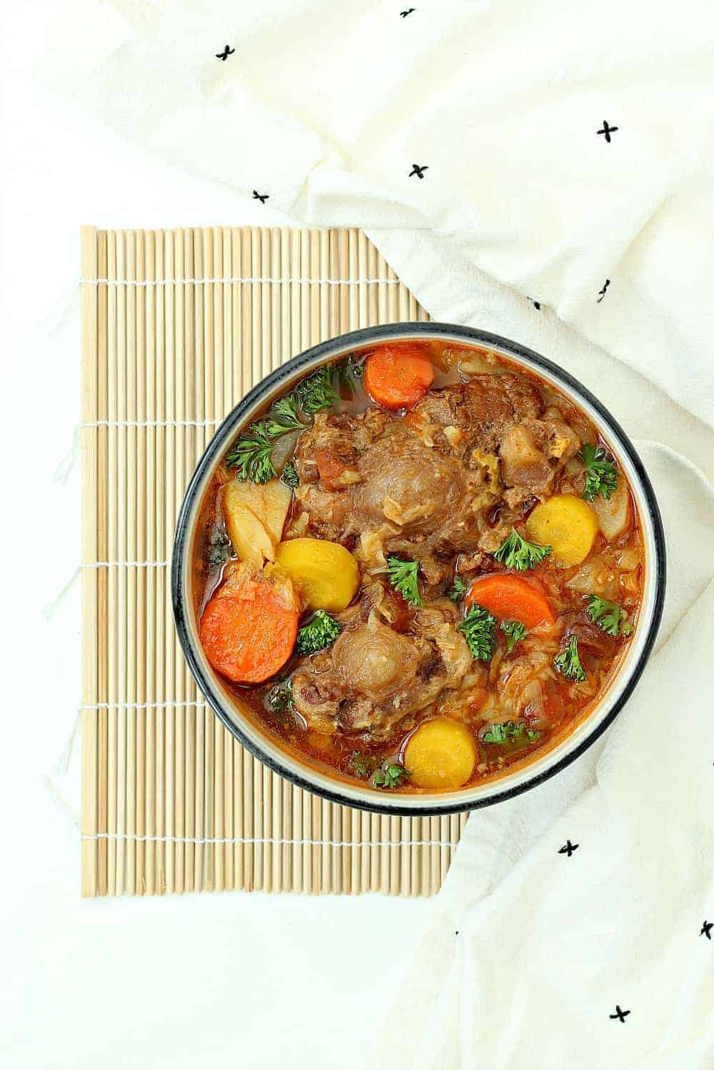 Instant Pot oxtail soup in a bowl on a table