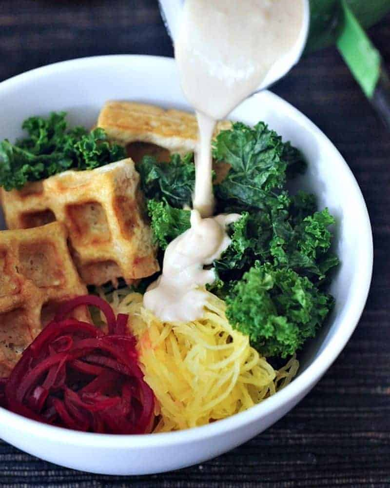 A bowl full of veggies and waffled tofu
