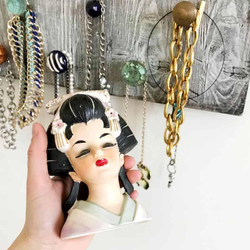 Hand holding rare Incarco Yumi geisha headvase