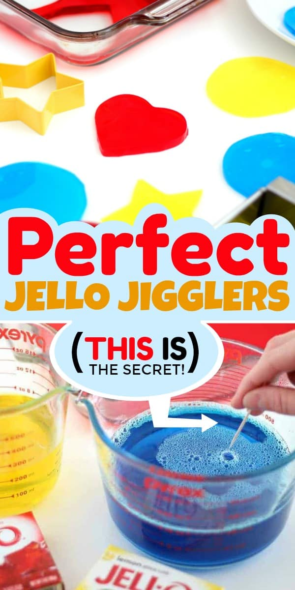 A hand popping bubbles in Jello Jigglers