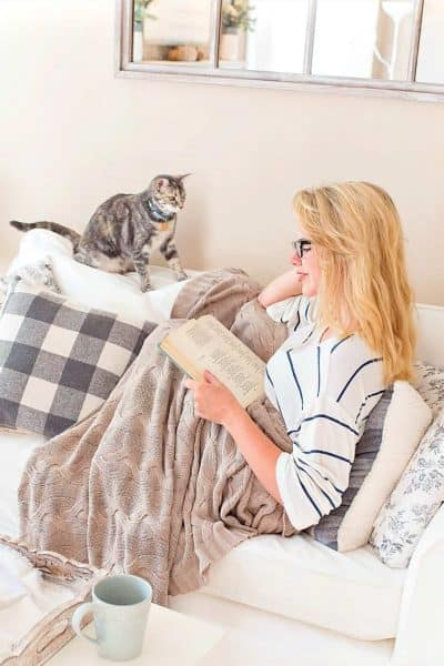 A lifestyle blogger at home with her cat