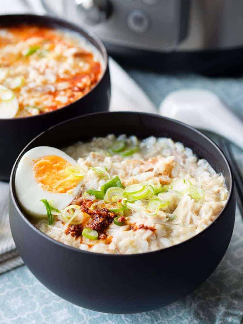 Instant Pot chicken soup congee in a black bowl