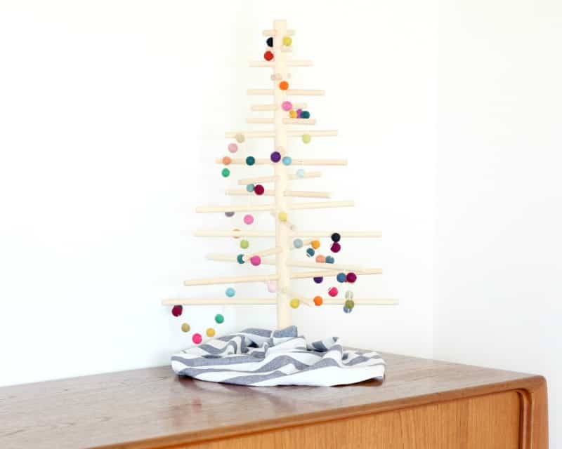 A felt ball garland on a minimalist Christmas tree