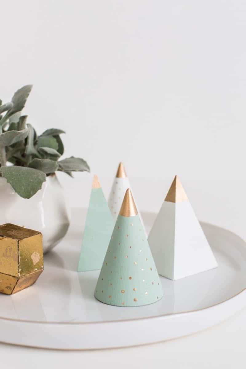 Three wooden minimalist Christmas trees on a platter