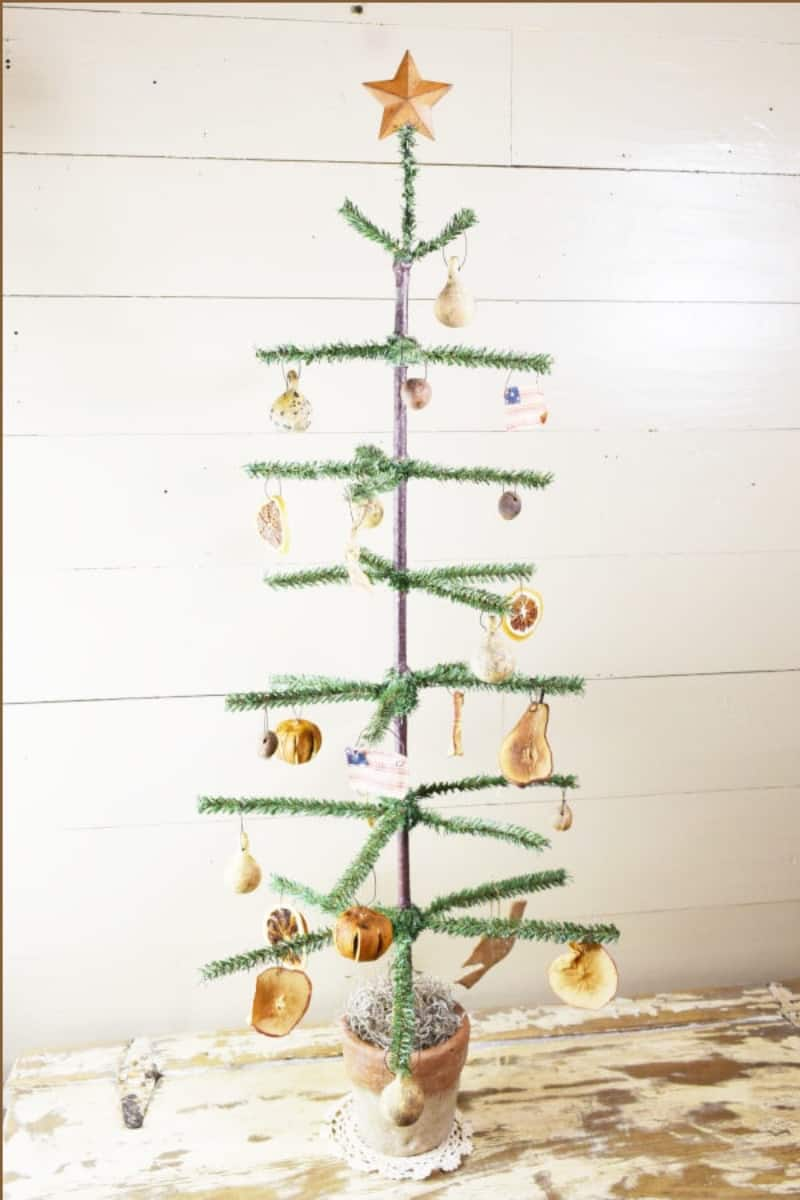 A primitive Christmas tree painted green