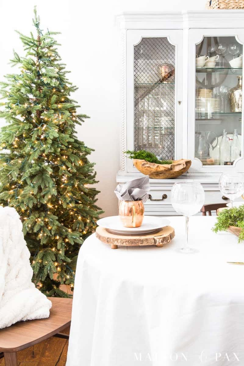 Beautiful minimalist Christmas tree lights on a green tree