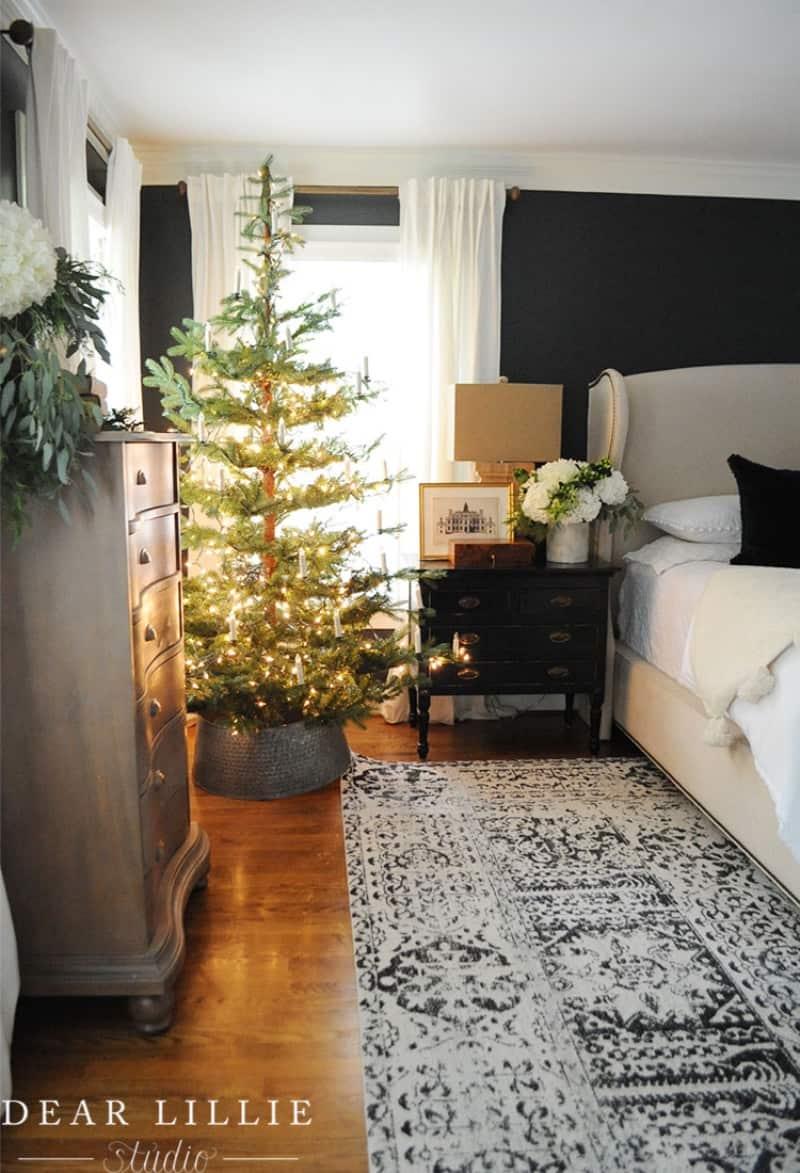 Minimalist Christmas tree lights on a green tree
