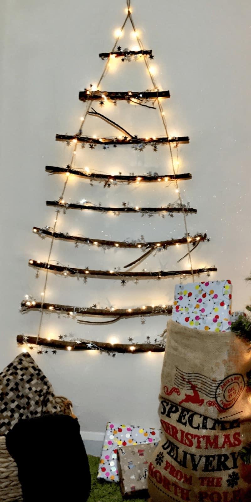 A twig wall Christmas tree with lights