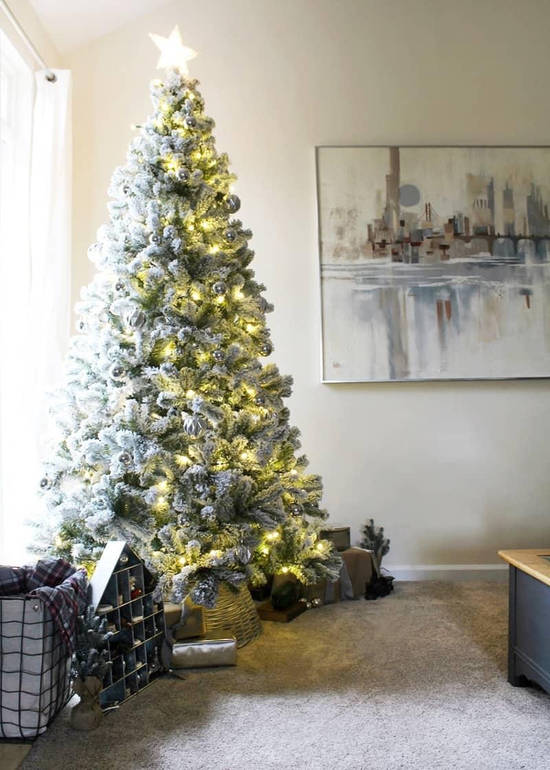 A green flocked minimalist Christmas tree