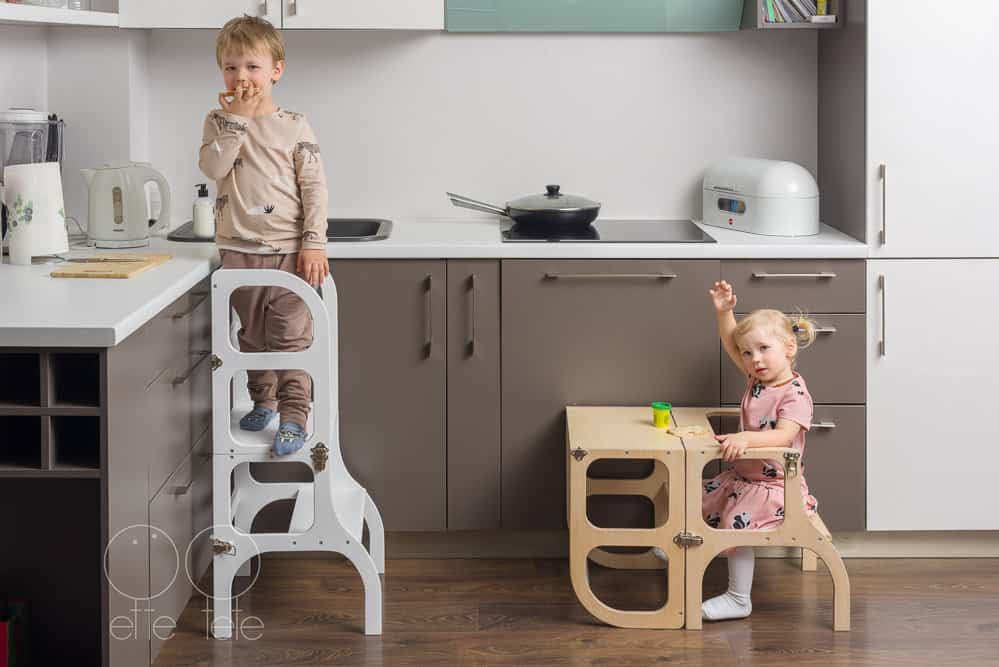 A boy and a girl enjoying their kitchen towers