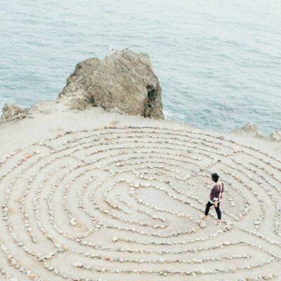 A minimalist walking in a stone mediation maze