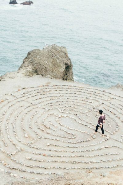 A minimalist walking in a stone mediation maze